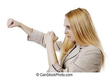 woman throwing a punch on white background - Pretty young...