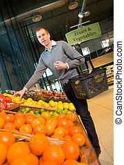 Fruits and Vegetables Grocery Store - A man buying fresh...