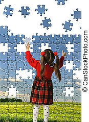 The girl assemble big puzzle. Landscape on a picture