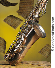 Old saxophone and flying musical notes on a background. The...