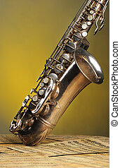 Old saxophone and notes The Musical instrument standing on...