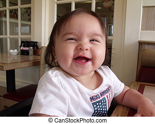 Chubby face female toddler laughing