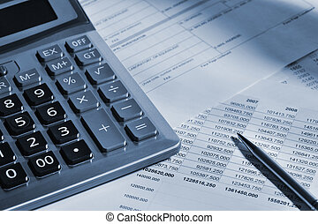 The calculator and the financial report. A workplace of the...