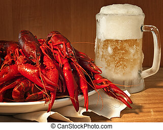 crawfishes - red boiled crawfishes on plate and beer
