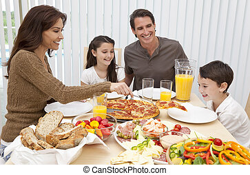 Parents Children Family Eating Pizza & Salad At Dining Table...