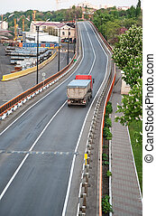 Automobile transportations. A lorry on asphalt to road