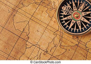 Old compass and map background. Old gold color