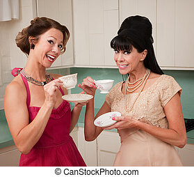 Women Enjoying Coffee - Two retro style women enjoying tea...