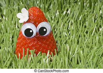 Happy in the grass Strawberry - Strawberry with eyes and a...