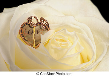 gold heart in a yellow rose - Ring in a yellow rose A...