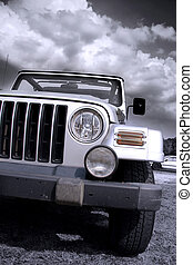 Off road vehicle - Close up shot of sport utility vehicle in...