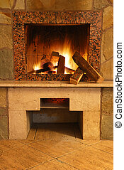Fireplace Flaring fire in a fireplace the reveted wild stone...
