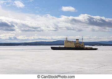 Icebreaker is on the White Sea on a sunny day