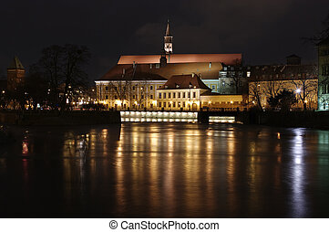 Night scene with river and buildings