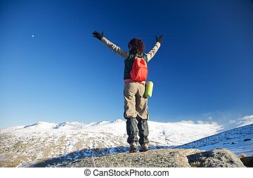 at the top of snow mountains - woman at Gredos mountains in...