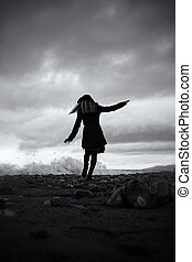 young woman on the sandy beaches of the storm