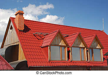 Red roof. A cottage constructed highly in mountains