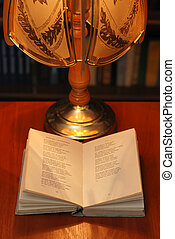 book of verses - The book of verses under light of a desk...