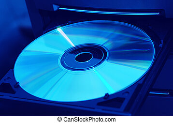 Disk in the drive blue - Disk in the drive. A photo close up...