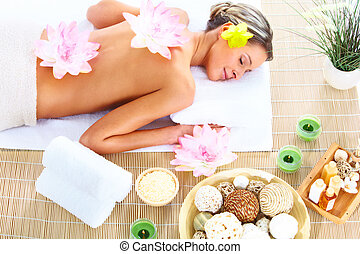 spa massage - Beautiful young woman getting spa massage....