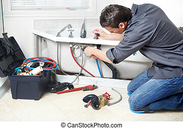 Plumber - Young handsome plumber repearing bath tub Service...