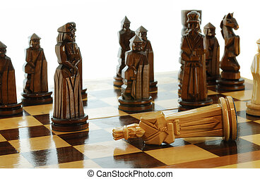 Death of king checkmate in a chess party Figures of a chess...