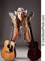 Sexy cowgirl in cowboy hat with acoustic guitar - Sexy...