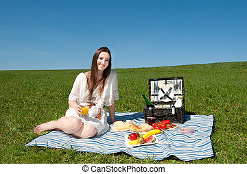Beautiful young woman having a picnic