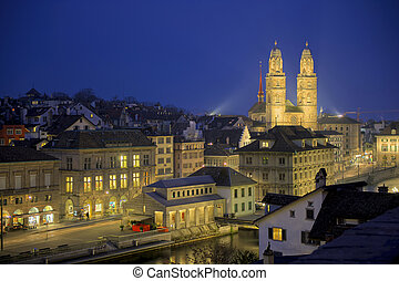 Zurich by night - Grossmunster cathedral near river Limmat...