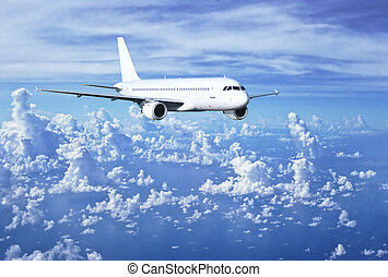 Airbus above clouds - Airbus plane flying in altitude over...