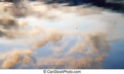 Clouds in Tidal Pool Widescreen - Clouds, golden from the...