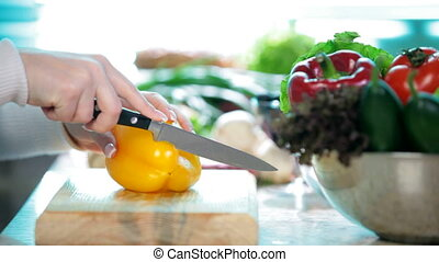 Chopping Pepper - Food Preparation - Cutting a yellow bell...