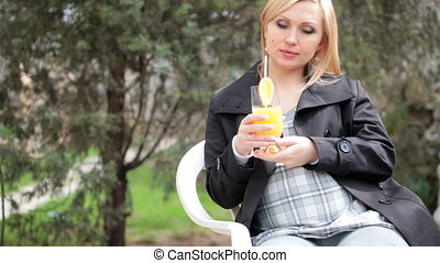 woman drinking orange juice - Pregnant woman drinking orange...