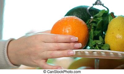 Holding fresh fruits - woman hand Holding fresh orange