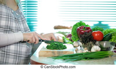Chopping herb parsley - Pregnant Woman slice herb parsley