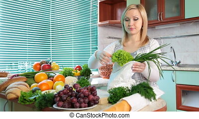 woman with Groceries in kitchen - Pregnant woman Unloading...