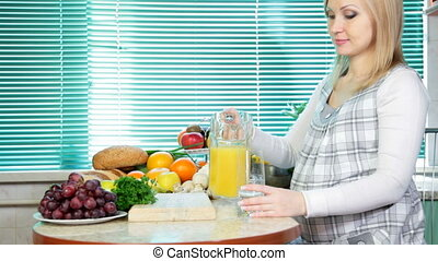 woman pouring orange juice