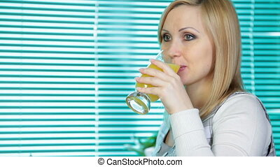 drinking orange juice - Pregnant woman drinking orange juice...