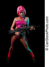Woman with gun - A sexy young woman in pink with