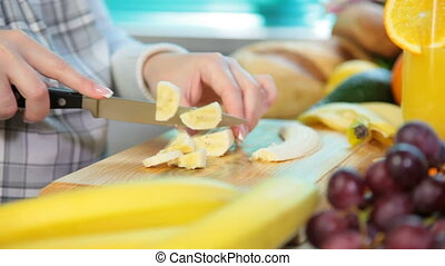 woman hands sliced banana