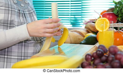 Pregnant woman sliced banana