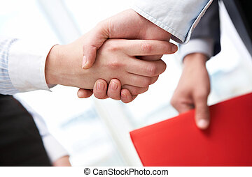 Handshaking - Image of business handshake after signing new...