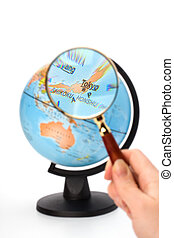 Japan map Hand holding magnifying glass over earth globe...