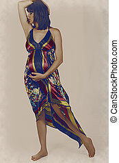 pregnant woman in long dress - artistic image of a pregnant...
