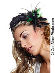 beautiful blond woman wearing green and black feather hair...