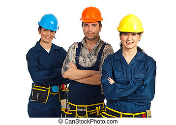Cheerful team of three constructor workers standing with...