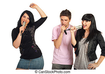Group of friends singing with microphones - Group of three...
