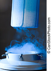 Opened container with liquid nitrogen, blue light and vapour
