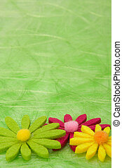 Spring background. Flowers on green sisal background. -...