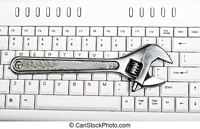 Hand tool on keyboard - Hand tool on an white keyboard
